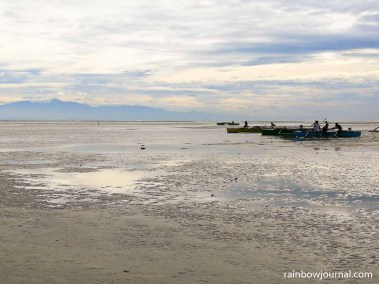 Fishermen at Tondol White Sand Beach