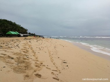 There is a compound of stores, eateries and accommodations  near the south end of Patar White Sand Beach