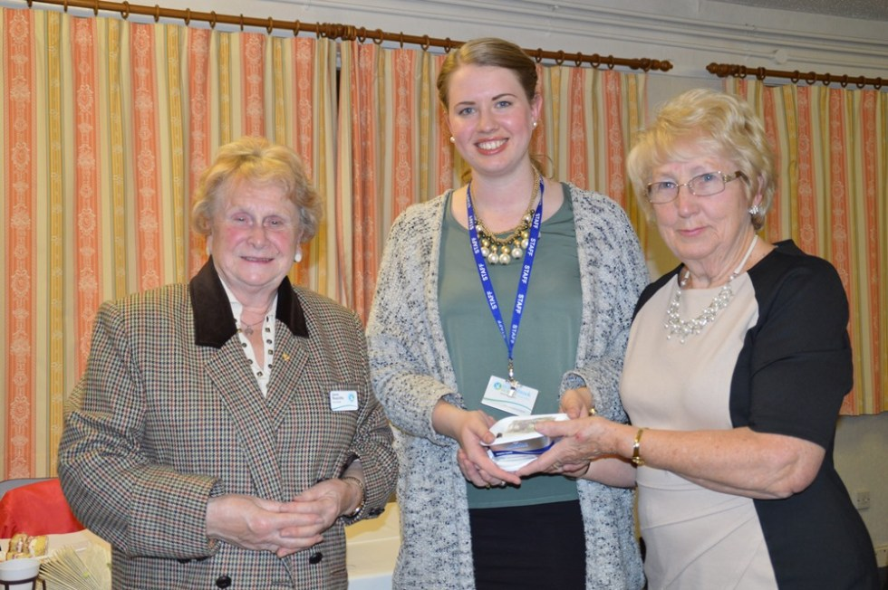 Janet & Emily accept the collection made on the evening from ladies of Rainhill WI