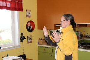 Susan learning how to set space with great intention before Reiki classes, sessions and events.
