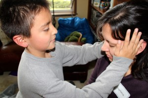 Jose practicing Reiki on his mom, Stephanie.