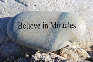 Positive reinforcement word Believe in Miracles engrained in a rock