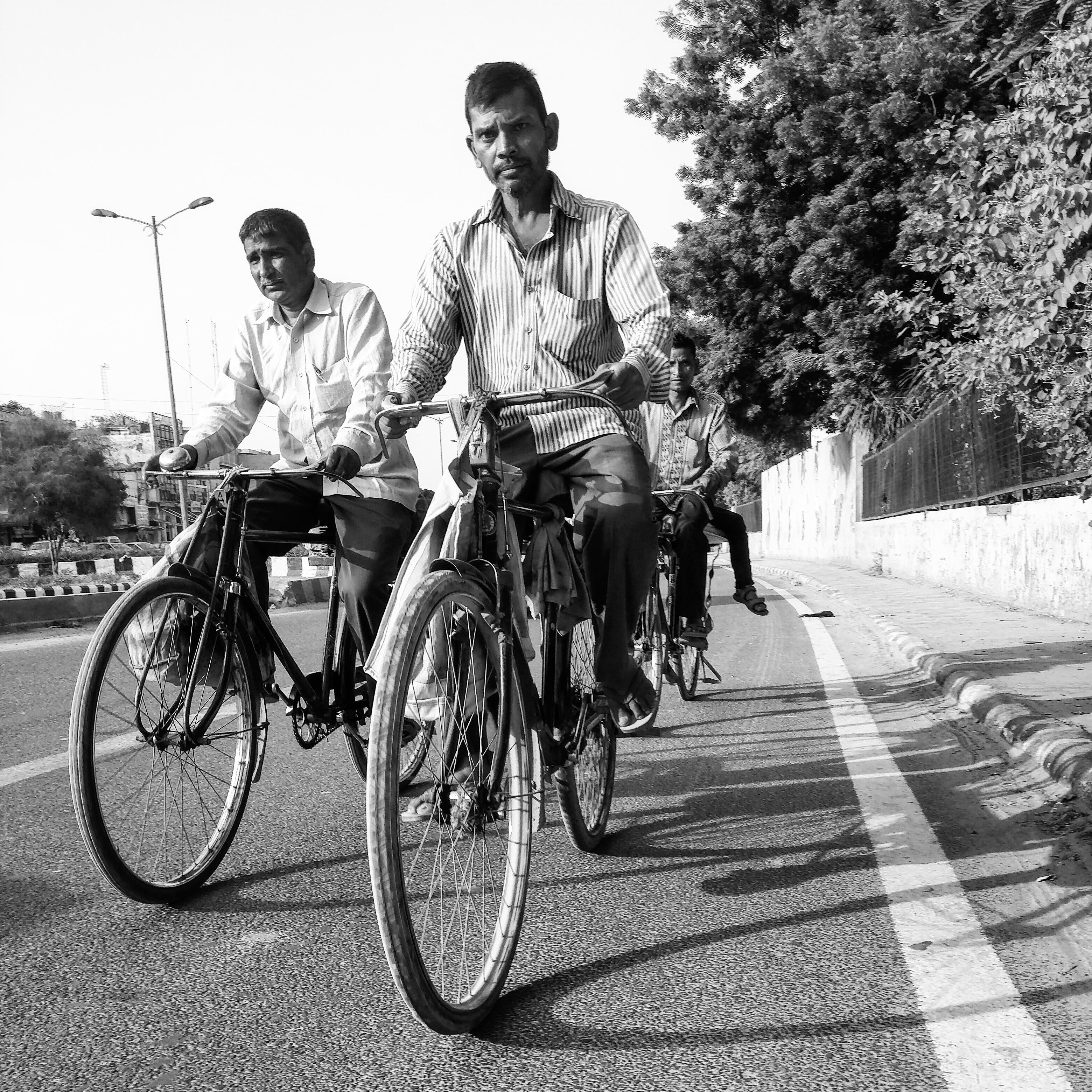 Men cycling back home after a day's hard-work. Majority of workers in Delhi are male.