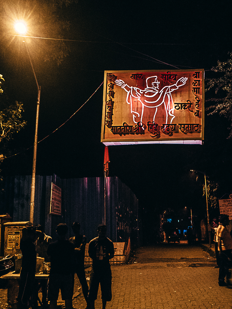 The Patriarch fondly called the Hindu Hriday Samrat orthe Emperor of the Hindu Hearts (Entrance to a slum)