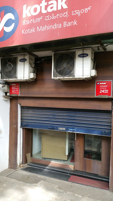 Another Kotak Mahindra ATM, out of service as indicated by the half shutters