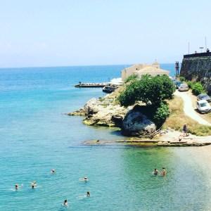 Bathers in the azure Adriatic in Corfu, Greece