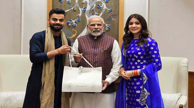 Indian Cricket Team Captain Virat Kohli and actor Anushka Sharma with Prime Minister Narendra Modi, in New Delhi on December 20, 2017.