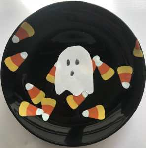 paper ghost in water on back and painted candy corn plate