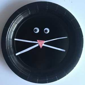 black paper plate cat face