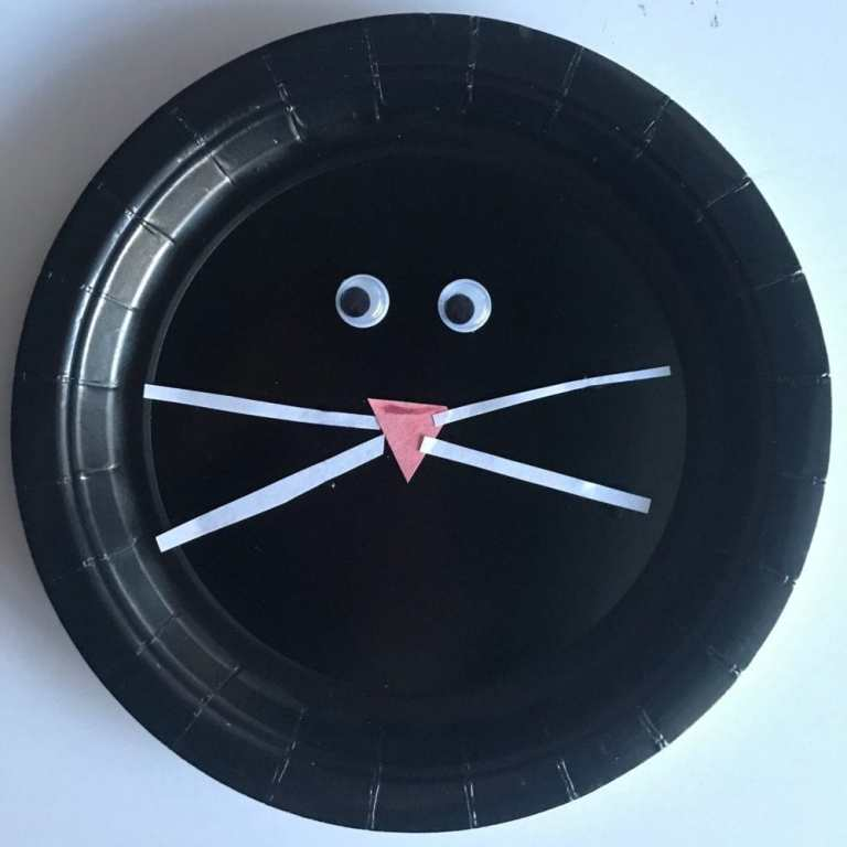 black paper plate cat face