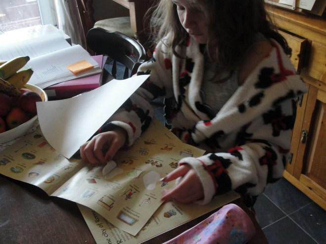 Ellie Working in Her Latin Sticker Book