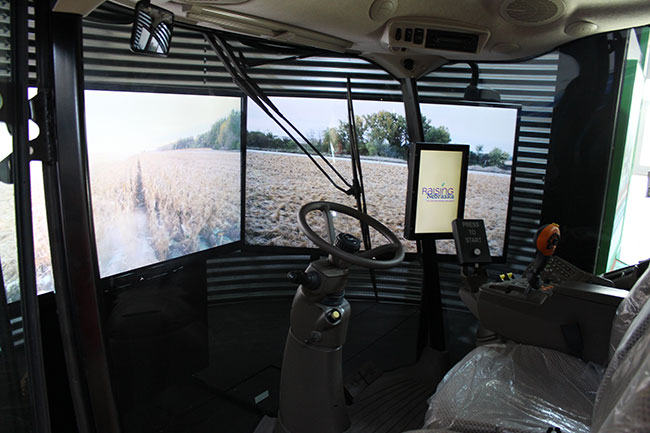 Sit in an actual combine cab and feel what it's like to harvest corn in the simulator.