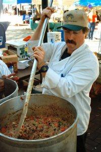 I hope he's stirring a gallon of icing into that big ol' pot!  Photo Credit: Joe Zlomek