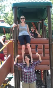 "Judye, showing her strength while ""holding Emily on her shoulders"" during a youth trip. - Summer 2012"