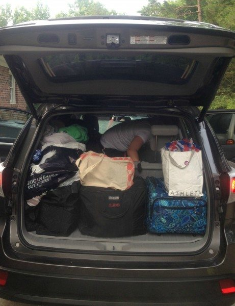 Packing bags in car before trip