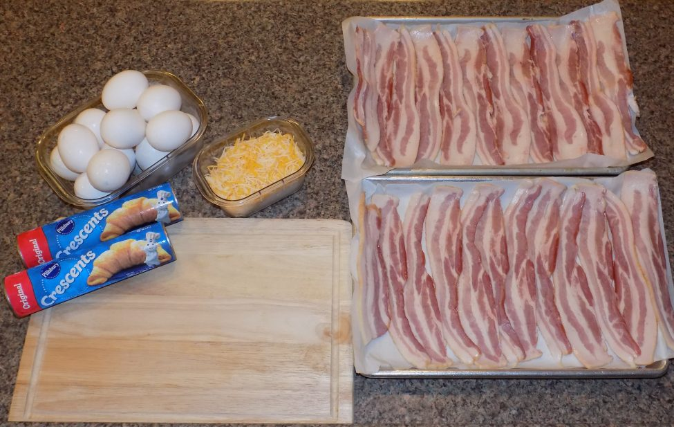 Crescent rolls, bacon, eggs, and cheese to be used for the breakfast sandwich.