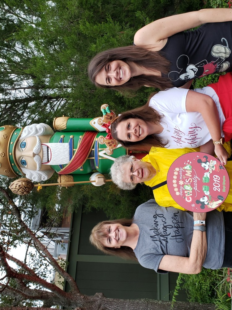 Three women standing in front of a giant nutcracker