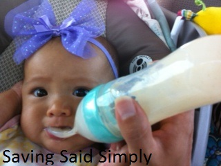 Baby being fed with Nuby Natural Touch Silicone Squeeze Feeder