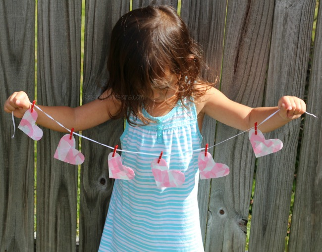 Adorable valentines day banner craft Mosaic Heart Valentine's Day Banner Kids Craft   make this adorable and easy Valentine's day craft for kids. Perfect heart banner to hang in the window. #kidscraft #valentines #DIY #Crafts