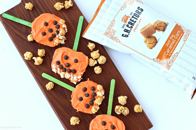 Fall popcorn snack for kids Need a festive fall snack that kids love? Try these Pumpkin Apple Pops for a fun Jack-O-Lantern inspired snack, featuring G.H. Cretors Popcorn #Snack #Halloween #Recipe