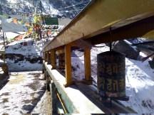 Buddhist prayer wheels on the bridge across tsomgo.