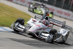 Jun 5, 2016; Detroit, MI, USA; Team Penske driver Will Power (12) of Great Britain rounds turn one during the Chevrolet Dual in Detroit Race 2 at The Raceway at Belle Isle Park. Will takes first place. Mandatory Credit: Raj Mehta-USA TODAY Sports