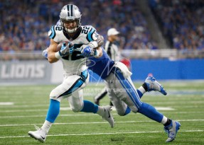 Oct 8, 2017; Detroit, MI, USA; Carolina Panthers running back Christian McCaffrey (22) turns and runs after a catch against Detroit Lions outside linebacker Paul Worrilow (58) during the second quarter at Ford Field. Mandatory Credit: Raj Mehta-USA TODAY Sports