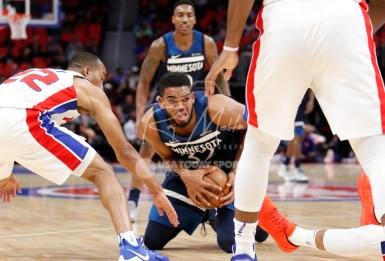 Oct 25, 2017; Detroit, MI, USA; Minnesota Timberwolves center Karl-Anthony Towns (32) gets control of the loose ball against Detroit Pistons guard Avery Bradley (22) during the first quarter at Little Caesars Arena. Mandatory Credit: Raj Mehta-USA TODAY Sports
