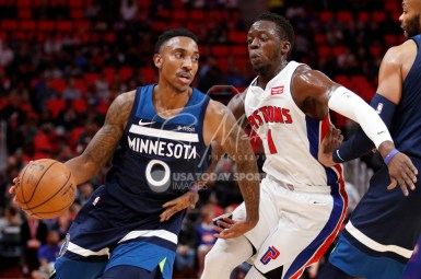 Oct 25, 2017; Detroit, MI, USA; Minnesota Timberwolves guard Jeff Teague (0) gets defended by Detroit Pistons guard Reggie Jackson (1) during the first quarter at Little Caesars Arena. Mandatory Credit: Raj Mehta-USA TODAY Sports