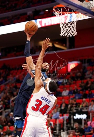 Oct 25, 2017; Detroit, MI, USA; Minnesota Timberwolves forward Taj Gibson (67) takes a shot over Detroit Pistons forward Tobias Harris (34) during the first quarter at Little Caesars Arena. Mandatory Credit: Raj Mehta-USA TODAY Sports