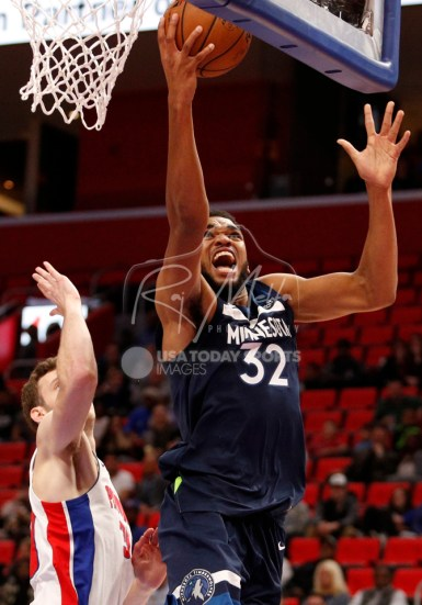 Oct 25, 2017; Detroit, MI, USA; Minnesota Timberwolves center Karl-Anthony Towns (32) goes up for a shot against Detroit Pistons forward Jon Leuer (30) during the second quarter at Little Caesars Arena. Mandatory Credit: Raj Mehta-USA TODAY Sports
