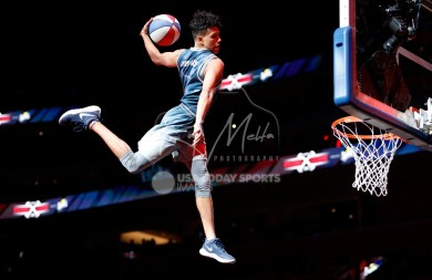 Oct 25, 2017; Detroit, MI, USA; A member of the Extreme Team dunks the ball just before the the fourth quarter in the game between the Detroit Pistons and the Minnesota Timberwolves at Little Caesars Arena. Mandatory Credit: Raj Mehta-USA TODAY Sports