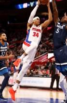 Oct 25, 2017; Detroit, MI, USA; Detroit Pistons forward Tobias Harris (34) goes up for a shot against Minnesota Timberwolves center Gorgui Dieng (5) during the fourth quarter at Little Caesars Arena. Mandatory Credit: Raj Mehta-USA TODAY Sports