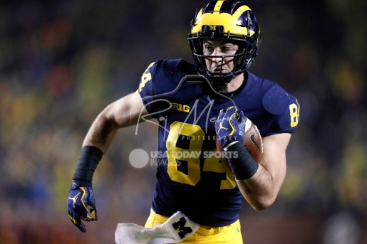 Nov 4, 2017; Ann Arbor, MI, USA; Michigan Wolverines tight end Sean McKeon (84) runs after a catch for a touchdown during the first quarter against the Minnesota Golden Gophers at Michigan Stadium. Mandatory Credit: Raj Mehta-USA TODAY Sports