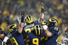 Nov 4, 2017; Ann Arbor, MI, USA; Michigan Wolverines running back Karan Higdon (22) celebrates with teammates after running for a touchdown during the third quarter against the Minnesota Golden Gophers at Michigan Stadium. Mandatory Credit: Raj Mehta-USA TODAY Sports