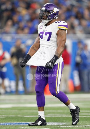 Nov 23, 2017; Detroit, MI, USA; Minnesota Vikings defensive end Everson Griffen (97) untucks his jersey to reveal writing on his shirt during the second quarter against the Detroit Lions at Ford Field. Mandatory Credit: Raj Mehta-USA TODAY Sports