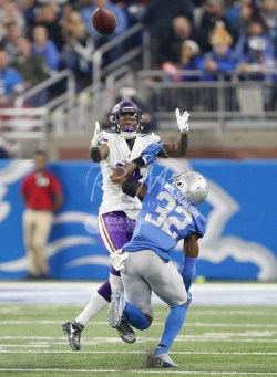 Nov 23, 2017; Detroit, MI, USA; Detroit Lions strong safety Tavon Wilson (32) breaks up a pass to Minnesota Vikings wide receiver Stefon Diggs (14) during the third quarter at Ford Field. Mandatory Credit: Raj Mehta-USA TODAY Sports