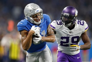 Nov 23, 2017; Detroit, MI, USA; Detroit Lions wide receiver Marvin Jones (11) makes a touchdown catch against Minnesota Vikings cornerback Xavier Rhodes (29) during the fourth quarter at Ford Field. Mandatory Credit: Raj Mehta-USA TODAY Sports