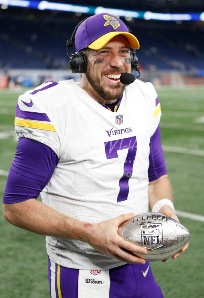 Nov 23, 2017; Detroit, MI, USA; Minnesota Vikings quarterback Case Keenum (7) holds the Fox NFL silver football award after the game against the Detroit Lions at Ford Field. Mandatory Credit: Raj Mehta-USA TODAY Sports