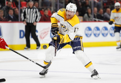 Feb 20, 2018; Detroit, MI, USA; Nashville Predators left wing Scott Hartnell (17) dumps the puck into the zone during the first period against the Detroit Red Wings at Little Caesars Arena. Mandatory Credit: Raj Mehta-USA TODAY Sports