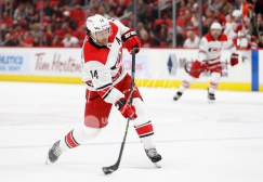 Feb 24, 2018; Detroit, MI, USA; Carolina Hurricanes right wing Justin Williams (14) shoots the puck during the first period against the Detroit Red Wings at Little Caesars Arena. Mandatory Credit: Raj Mehta-USA TODAY Sports