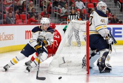 Feb 22, 2018; Detroit, MI, USA; Buffalo Sabres defenseman Casey Nelson (8) skates behind goaltender Robin Lehner (40) as Detroit Red Wings left wing Darren Helm (43) tries to catch up during the second period at Little Caesars Arena. Mandatory Credit: Raj Mehta-USA TODAY Sports