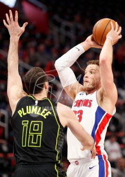 Feb 14, 2018; Detroit, MI, USA; Detroit Pistons forward Blake Griffin (23) looks for an open man against Atlanta Hawks center Miles Plumlee (18) during the first quarter at Little Caesars Arena. Mandatory Credit: Raj Mehta-USA TODAY Sports