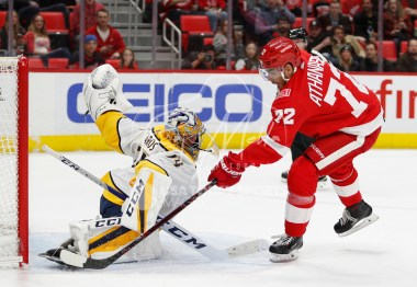 Feb 20, 2018; Detroit, MI, USA; Detroit Red Wings left wing Andreas Athanasiou (72) scores a goal against Nashville Predators goaltender Juuse Saros (74) during the second period at Little Caesars Arena. Mandatory Credit: Raj Mehta-USA TODAY Sports