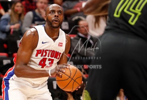 Feb 14, 2018; Detroit, MI, USA; Detroit Pistons forward Anthony Tolliver (43) looks to take a shot against Atlanta Hawks center Dewayne Dedmon (14) during the second quarter at Little Caesars Arena. Mandatory Credit: Raj Mehta-USA TODAY Sports