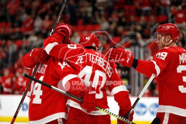 Feb 24, 2018; Detroit, MI, USA; Detroit Red Wings center Henrik Zetterberg (40) celebrates with teammates after scoring a goal during the second period against the Carolina Hurricanes at Little Caesars Arena. Mandatory Credit: Raj Mehta-USA TODAY Sports
