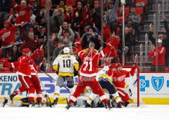 Feb 20, 2018; Detroit, MI, USA; Detroit Red Wings left wing Tomas Tatar (21) celebrates with center Dylan Larkin (71) and left wing Justin Abdelkader (8) after scoring a goal on Nashville Predators goaltender Juuse Saros (74) during the third period at Little Caesars Arena. Mandatory Credit: Raj Mehta-USA TODAY Sports