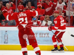 Feb 24, 2018; Detroit, MI, USA; Detroit Red Wings defenseman Trevor Daley (83) smiles at center Dylan Larkin (71) after scoring a goal during the second period against the Carolina Hurricanes at Little Caesars Arena. Mandatory Credit: Raj Mehta-USA TODAY Sports