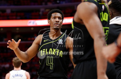 Feb 14, 2018; Detroit, MI, USA; Atlanta Hawks forward Andrew White III (4) celebrates with the bench during the third quarter against the Detroit Pistons at Little Caesars Arena. Mandatory Credit: Raj Mehta-USA TODAY Sports