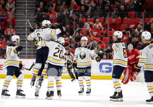 Feb 22, 2018; Detroit, MI, USA; Buffalo Sabres defenseman Marco Scandella (6) celebrates with teammates after scoring the game winning goal in overtime against the Detroit Red Wings at Little Caesars Arena. Mandatory Credit: Raj Mehta-USA TODAY Sports